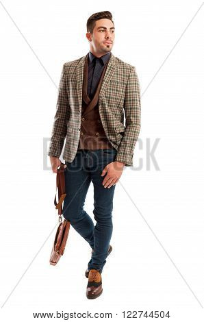 Casual and retro fashionable business man wearing plaid suit jacket and jeans