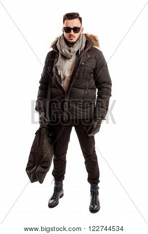 Fashionable Male Model Wearing Winter Clothes And A Big Bag