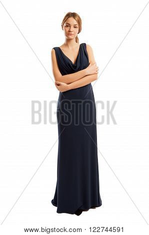 Confident And Beautiful Female Model Wearing A Long Dress