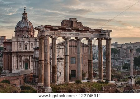 Rome, Italy: The Roman Forum, Latin: Forum Romanum, Italian: Foro Romano, in the sunrise. Santi Luca e Martina Church poster