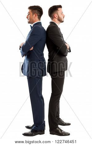 Competitive Business Men Standing Back To Back