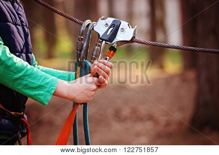 Climbing Sports Image Of A Carabiner On A Metal Rope In A Forest
