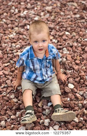A Boy On Stones