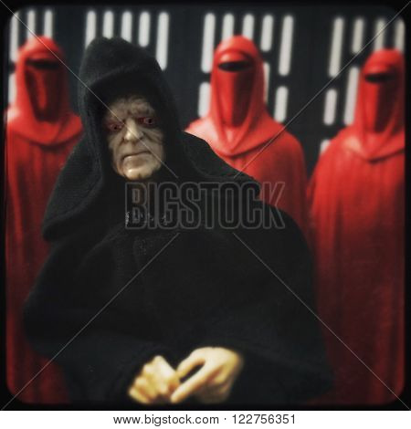 BLOOMFIELD, NJ -  MARCH 15, 2016: A recreation with action figures of a scene from Star Wars showing Emperor Palpatine / Darth Sidious and his Royal Guard - filtered image