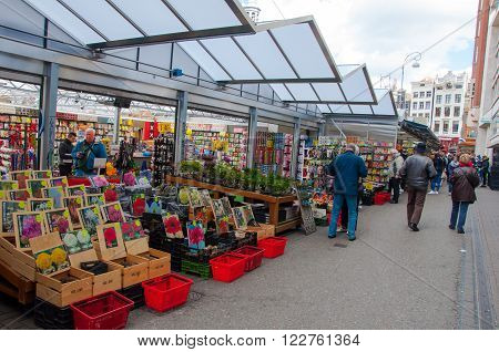 AMSTERDAM-APRIL 28: Small shops offer plenty houseplants and bulbs on the Amsterdam Flower Market on April 282015.The Flower market is one of Amsterdam most colourful attractions.