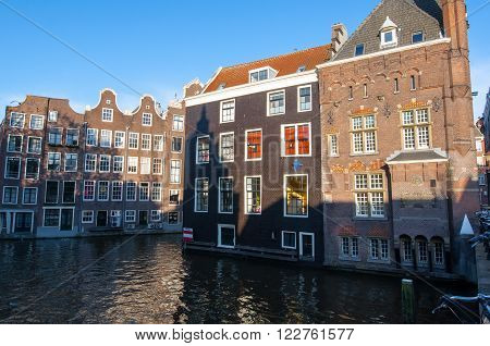 Amsterdam buildings on the water in red light district. The Netherlands.