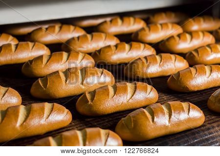 Bread in the furnace. Baking buns. Confectionery. Plant for the production of bread.