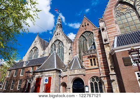 Amsterdam-April 27: Oude Kerk (Old Church) in Amsterdam's red-light district on April 272015 the Netherlands.