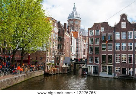 Amsterdam-April 27: Red light district the Church of St. Nicholas is visible in the background on April 272015 the Netherlands.