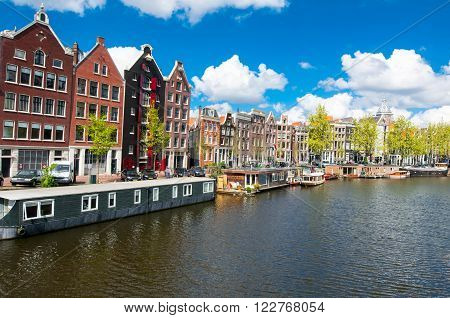 Amsterdam the Netherlands-April 27: Traditional Amsterdam cityscape on April 272015. Amsterdam is the most populous city of the Kingdom of the Netherlands.