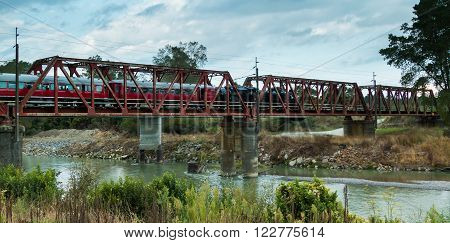 Stream train cross over one of New Zealands trestle bridge over the Rangitikei river.