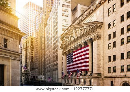 Famous Wall street and the building in New York New York Stock Exchange with patriot flag