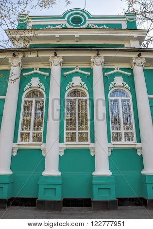 ALMATY KAZAKHSTAN - MARCH 21 2016: Old merchant's house with stucco floral ornaments was built in the early 20th century by order of Titus Golovizin - Verny master shoemakers.