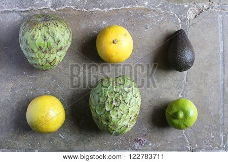 Cherimoya fruit oranges and lime and avocado flat lay arrangement poster