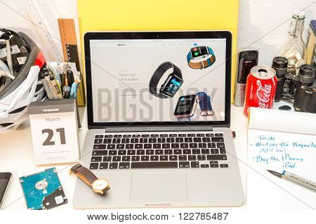 PARIS FRANCE - MARCH 21 2016: Apple Computers website on MacBook Pro Retina in a geek creative room environment showcasing the newly announced Apple Watch bands