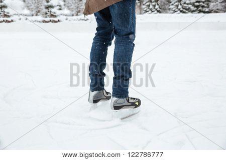 Closeup portrait of a male legs in ice skates