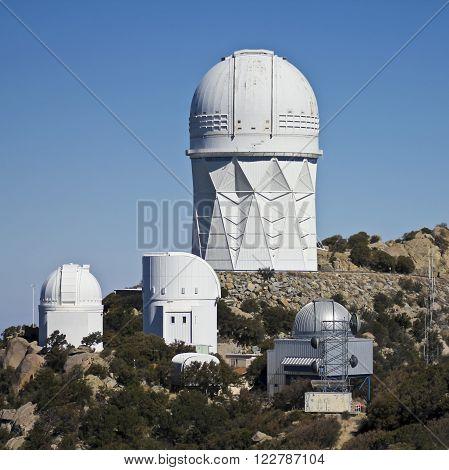 TUCSON, ARIZONA, FEBRUARY 28. Kitt Peak National Observatory on February 28, 2016, near Tucson, Arizona. A view of four of the large telescopes at Kitt Peak National Observatory near Tucson Arizona.