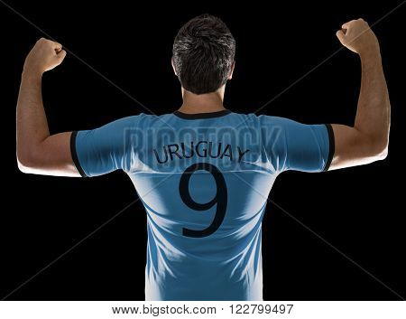 Uruguayan soccer player on black background