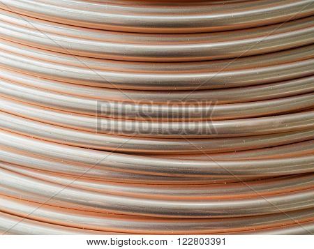 Detail of a coil of copper tubes used in the industry of air conditioning.