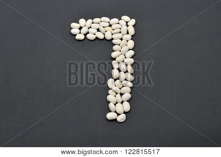 Number Seven Made From White Beans On Black Background. Food Vegan, Vegetarian. Healthy Food