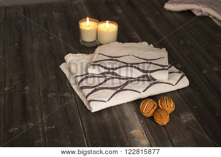 Folded Towel And Napkin With Black Concave Line Design