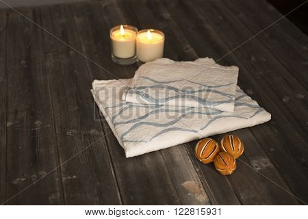 Folded Towel And Napkin With Blue Concave Line Design