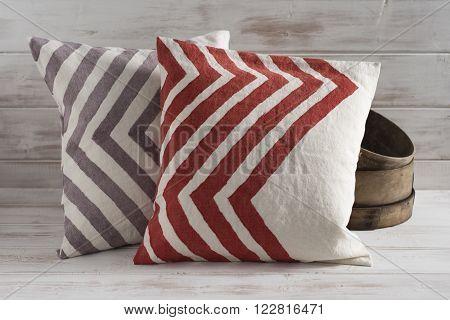 Two Front-facing Throw Pillows With Chevron Design