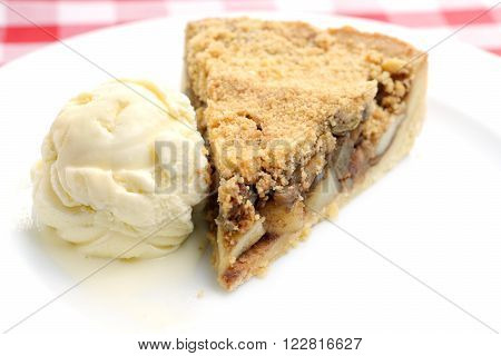 Applepie with icecream,  on a white plate