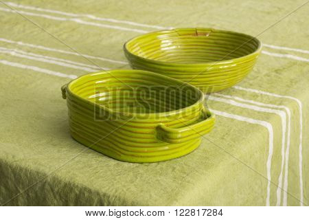 Green Earthenware Deep Dish And Bowl On Green Linen