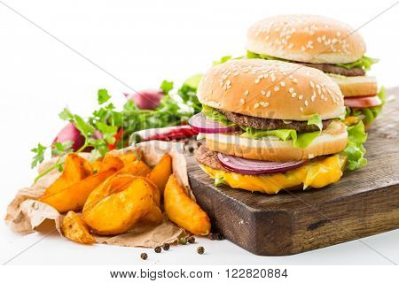 Tasty hamburger and fries on a white background