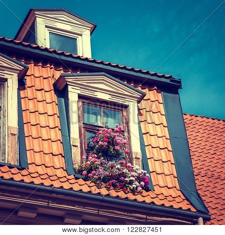 Window with flower box in old garret roof.
