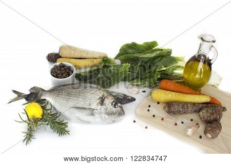 Delicious fresh fish isolated on white  background. Fish with  spices and vegetables - healthy food, diet or cooking concept