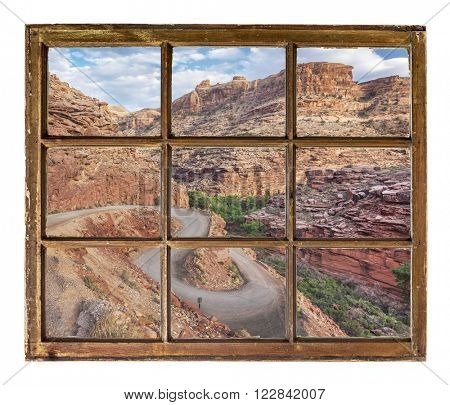 windy canyon road  as seen  through vintage, grunge, sash window with dirty glass