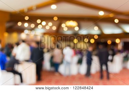 Bokeh light and blurred people in convention hall