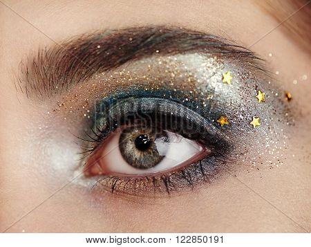Beautiful woman eye. Perfect makeup. Beauty fashion. Eyelashes. Lips. Cosmetic Eyeshadow. Make-up detail. Eyeliner.