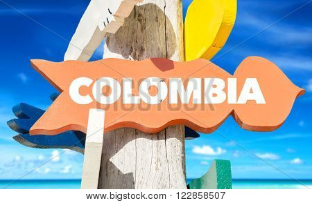 Colombia signpost with beach background