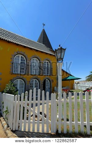 SWAKOPMUND, NAMIBIA - October 8, 2014: Beautiful colonial German architecture on stret of Swakopmund. City was founded in 1892, by Captain Curt von Francois as the main harbour of German South West Africa.