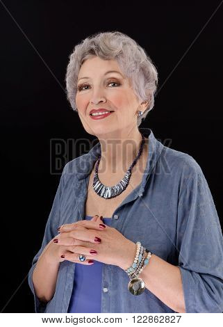 Portrait classy older woman with paua shell stick bar beads