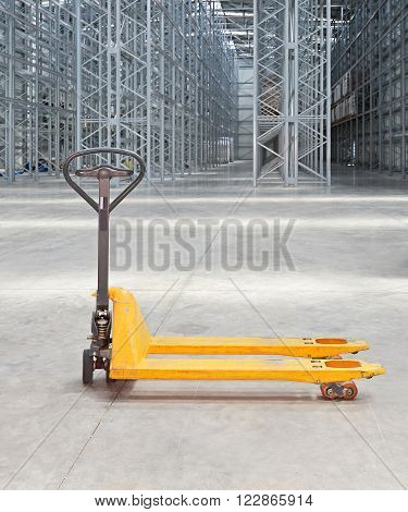 Manual Pallet Truck in Distributin Center Warehouse