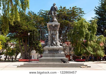 Punta Arenas Chile - December 9 2012: Monument to Fernando de Magallanes. Locals and tourists come to touch or kiss the feet of the Indian who is reclining on the stone base of the monument the legend says that the person who does will return to Punta Are