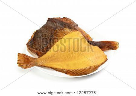 Two hot smoked flatfish on plate isolated on white