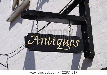 Old rustic antiques sign on a Tudor building Tewkesbury Gloucestershire England UK Western Europe.