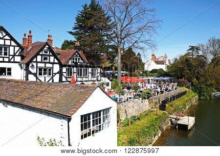 SHREWSBURY, UK - APRIL 22, 2015 - People having lunch outside The Boathouse Pub alongside the River Severn Shrewsbury Shropshire England UK Western Europe, April 22, 2015.