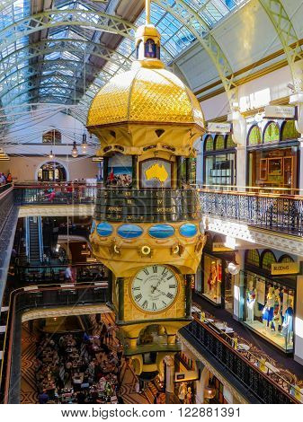 Sydney, Australia - February 02, 2015: Golden clock tower in shopping center with calendar and time and decorations