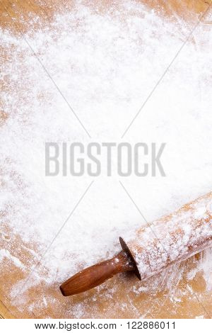 baking background with pastry board and rolling pin