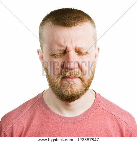 Bearded man in a T-shirt with his eyes closed