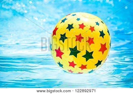 Inflatable ball floating in swimming pool, Close up image