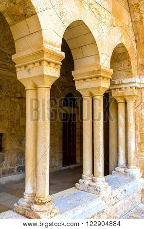BETHLEHEM PALESTINE - FEBRUARY 18 2016: The rows of columns of the Franciscan courtyard of the Church of the Nativity on February 18 in Bethlehem.