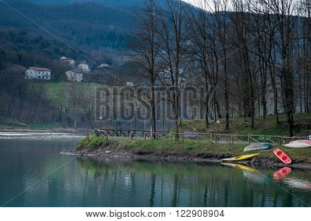 Artificial lake of Pontecosi in Garfagnana in the region of Tuscany railroad bridge and a little church from a stone little bridge