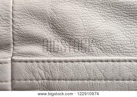 White leather stitching detail, close up shot